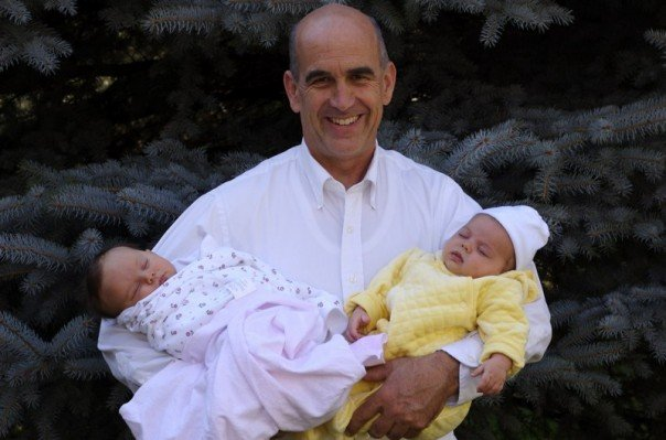 This is my favorite picture of my dad with babies Lucy and Olive